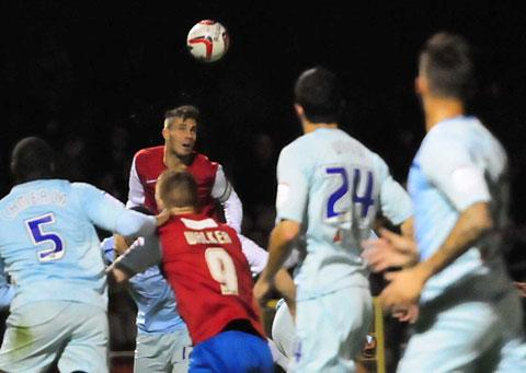 York City skipper Chris Smith threatens the visiting defence with a towering header
