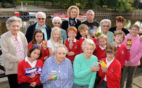 Sutton-upon-Derwent School pupils with City Mills residents and Councillor Tracey Simpson-Laing. The school handed out harvest festival goods to those affected by last month's floods