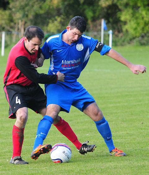 Terrington Glory's Andrew Frank loses out Old Malton St Mary's goalscorer Rob Baker,