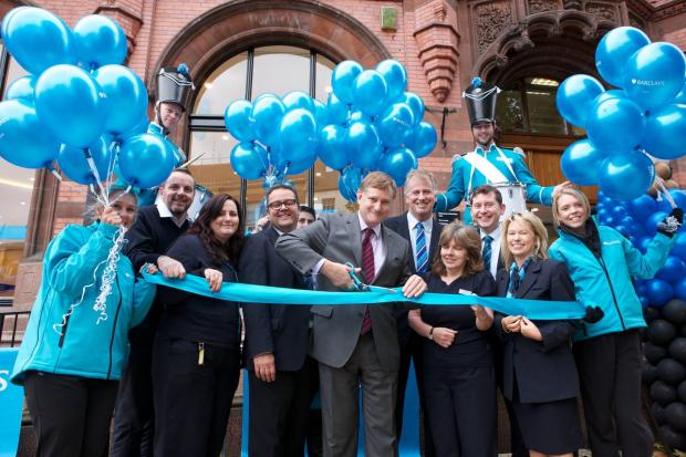 Hugh Bayley, MP for York Central, cuts the ribbon to the new branch with Barclays staff