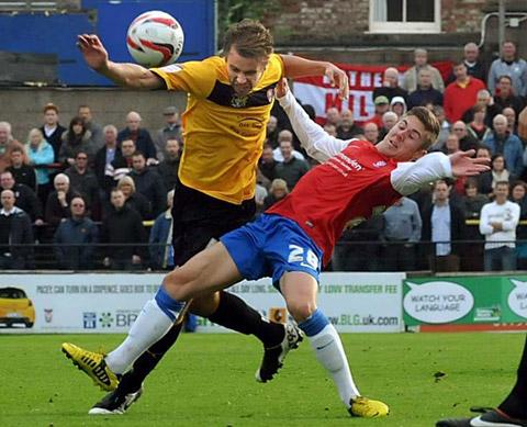 Daniel Kearns  is pictured being put  under pressure on his York  City debut against Rotherham United in  npower  League Two  at Bootham Crescent