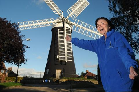 Chris Weaire celebrates outside the Holgate Rise windmill.