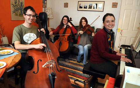 Musicians, from left, David Hammond, Catherine Strachan, Helen Bell and Laura Jones tune up for tonight's fundraising concert