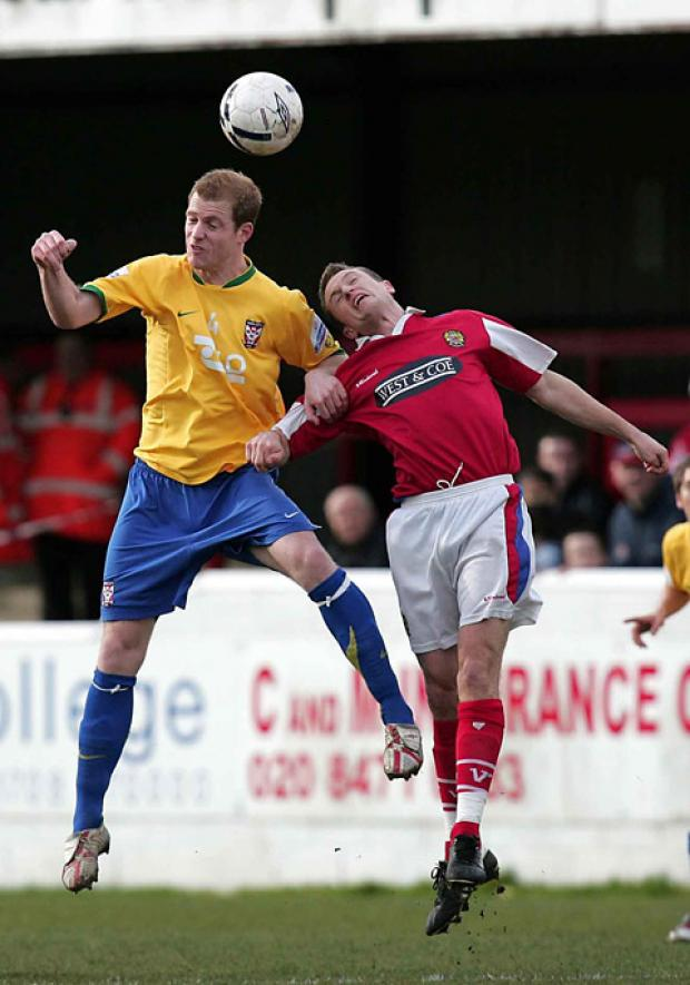 York City's Neal Bishop, left, makes an aerial challenge in the Minstermen's  last clash with Dagenham & Redbridge in February 2007