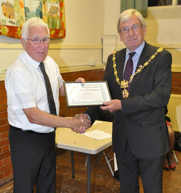 John Jeffery is presented with his long service award by the Sheriff of York, Coun Paul Firth