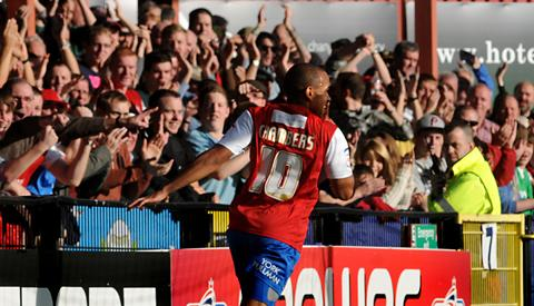 Ashley Chambers celebrates the first of his two goals in the 3-2 victory over Dagenham & Redbridge in npower League Two at Bootham Crescent