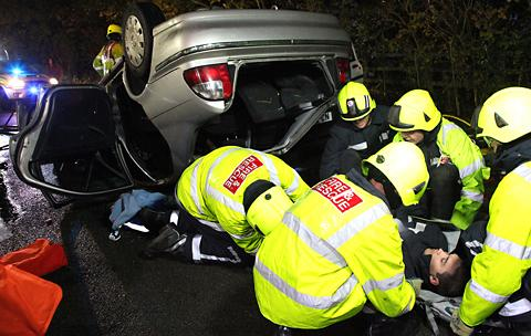 Fire crews work to rescue 'victims' in the simulated five-car accident at Huntington Fire Station