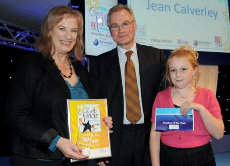 Jean Calverley and pupil Megan Long receive the award from Peter Emery of Drax Power Limited