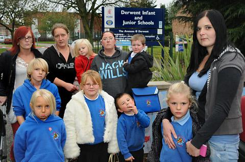 With their children at Derwent School, which could merge with nearby Osbaldwick School, are, from the left, Tanya Turpin, Amanda Willis, Louise Quinn and Charlotte Cowling