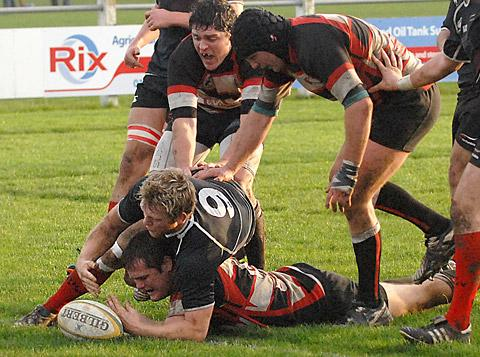 Alex Whittaker, who battles to ground a try, returns for Malton & Norton