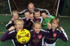 Teacher Paul Bentley with Knavesmire Primary School's footballers, who won the York Primary CADE Trophy
