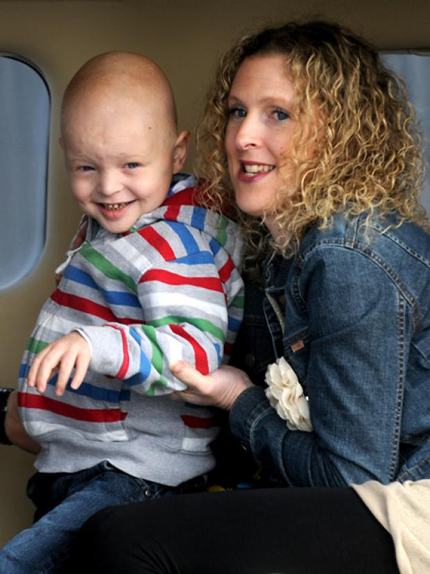Jamie Inglis, with his mum Vicky,   returning home earlier this month after  receiving treatment in Germany