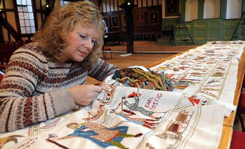 Mary Ann Dearlove, one of the team of embroiderers, putting the finishing  touches to the tapestry at York's Merchant Adventurers' Hall in December last yea