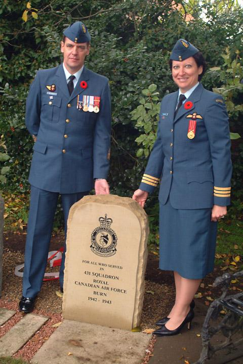 Lt Col Marysce Carmichael, commanding officer 431 Squadron, and Chief Warrant Officer Allan Blakley unveil the memorial stone