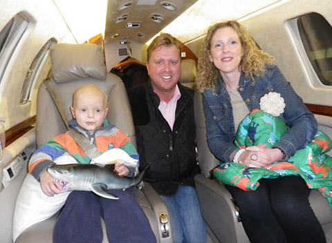 Jamie Inglis and his mum Vicky on the private plane with Andrew Whitney