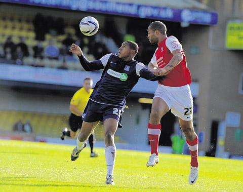 York City centre-back Clarke Carlisle, right, heads the ball away under pressure from Southend United's Gavin Tomlin in a man of the match display during Saturday's 0-0 draw in npower League Two at Roots Hall