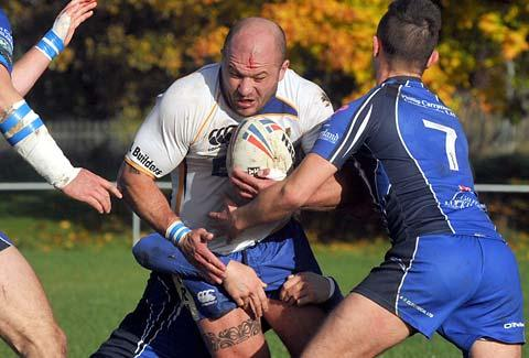 York Acorn's Adam Endersby charges into the Egremont defence