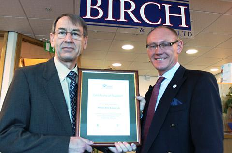 Chris Birch, left, receiving the Reserve Forces certificate from Richard Lenton