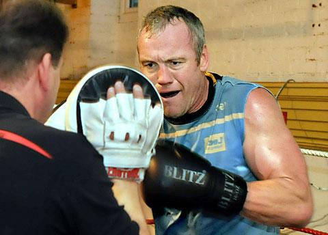 Brian McDermott pads up to Henry Wharton