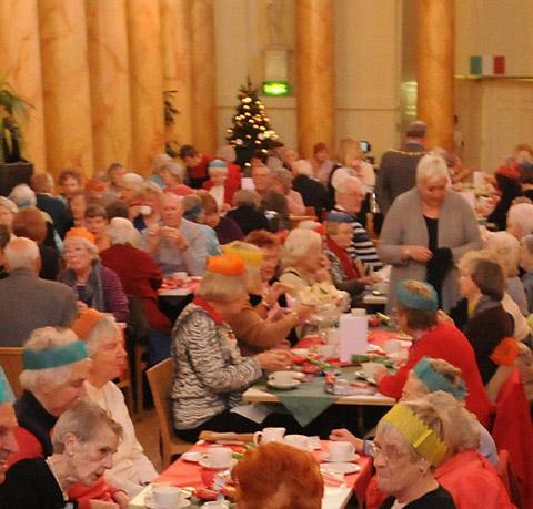 People enjoying last year's Christmas Cheer event in the Assembly Rooms