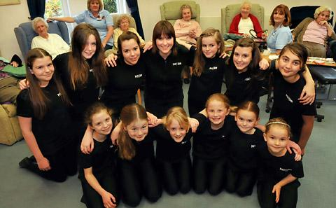 Emma Bassett, centre, and her pupils at Perform, who entertained residents in the day centre at St Leonards Hospice