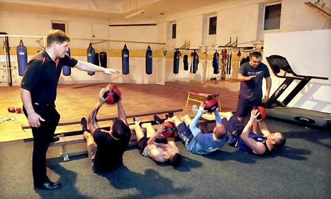 Ron Hopley putting boxers through their paces in a joint training session held with, left, Henry Wharton