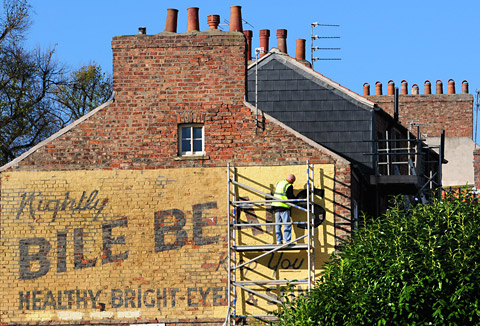 Work begins on repainting the Bile Beans sign on Lord Mayor's Walk