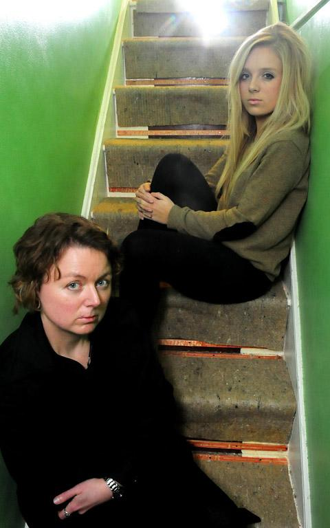 Rowena Freeman with her daughter, Alicia, on the staircase where the carpet had to be removed following a party