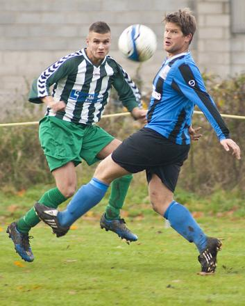 Wigginton hat-trick hero Lee McQuade, left, swings in a cross as a King William player closes in.  Picture: Ian Parker
