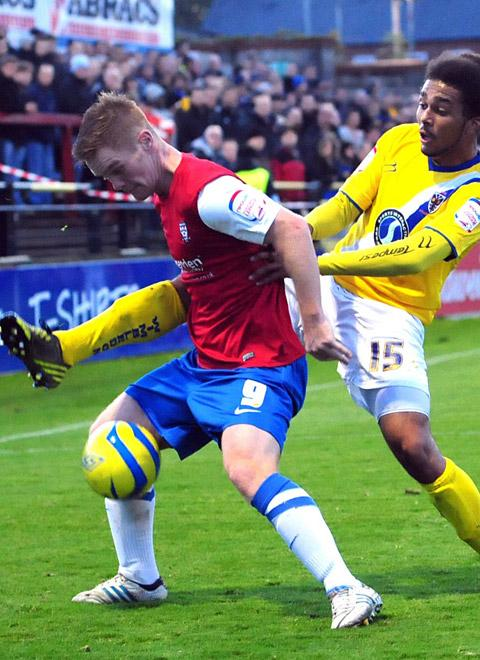 AFC Wimbledon's Louis Harris in action against York City's Jason Walker