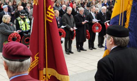 Flag bearers at the North Eastern Railway Cenotaph in York for the remembrance service.