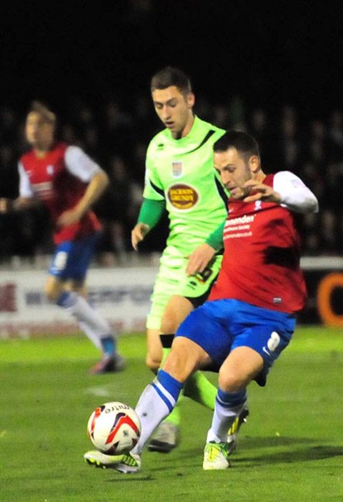 York City midfielder Scott Kerr, below right, in action against Northampton on Tuesday night