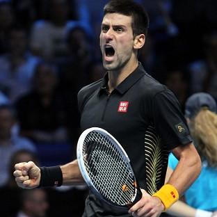 Serbia's Novak Djokovic celebrates winning the Barclays ATP World Tour Finals