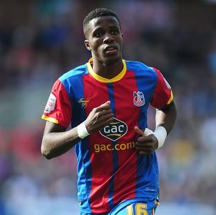 Wilfried Zaha is yet to make a decision on his international future