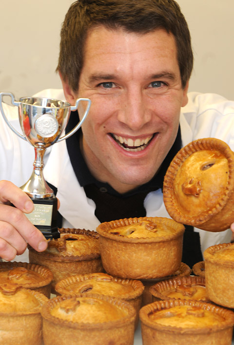 York butcher Lee Bell with his pork pie which was          runner-up in the 23rd Annual Great Yorkshire Pork Pie and Sausage Competition in Bradford