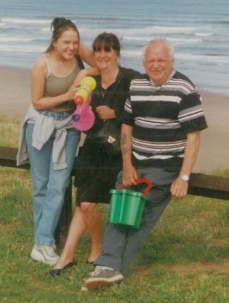 Toni with her mum and dad on a family holiday