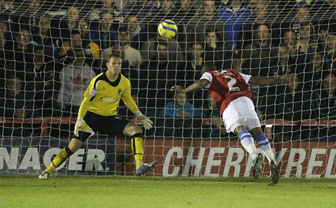 York City's Lanre Oyebanjo launches himself into the air but his diving header goes over the AFC Wimbledon crossbar