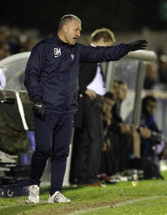 Gary Mills watches his men fall from the FA Cup