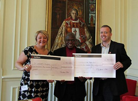 The Archbishop of York, centre, presents cheques to Sue Miller, of St Leeonard's Hospice, and Robin Rolls, of the Youth Trust