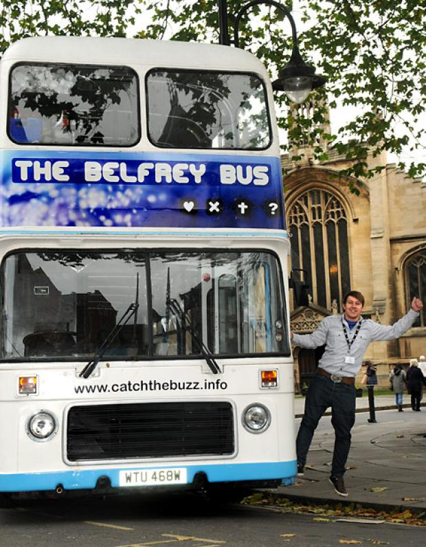 Lee Kirkby, the new youth worker for St Michael le Belfrey Church, on the double-decker bus which will tour York as a mobile youth centre