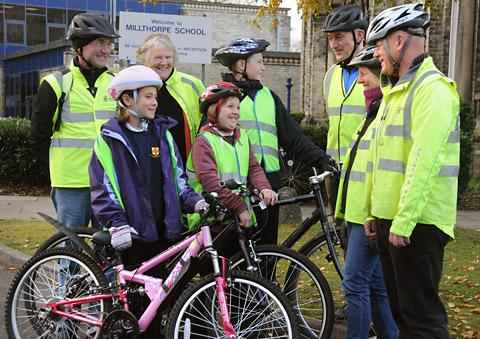 Front, Lydia Mellen and Luke Smith get advice from their instructors. Back, from left, are cycle trainer John Bullock, Councillor Janet Looker, and instructors Rob Bartlet, Angela Blackwood and Billy Geraghty