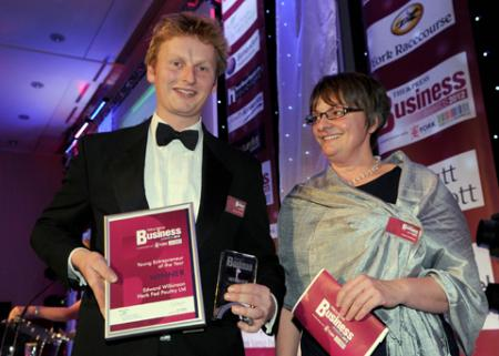 Young Entrepreneur winner Edward Wilkinson on stage with the Dean of York St John Business School, Jackie Mathers.