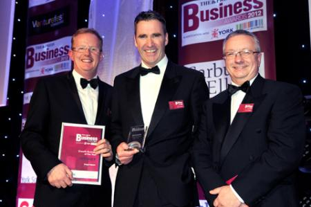 CY Coach Phil McTaggart (right) presents the Growth Business of the Year Award to Inspirepac's Mark Hawkins (left) and Chris Marples.