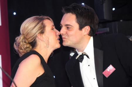 James Buffoni of the Ryedale Group steals a kiss on stage from presenter Kate Walby.