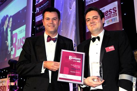 James Buffoni, right, of the Ryedale Group, receives the Family Business Of The Year award from Garbutt & Elliott's Craig Manson, one of three awards won by the Ryedale Group last night