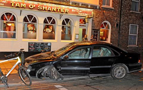 The scene after the black Volvo crashed in Lawrence Street outside the Tam O'Shanter