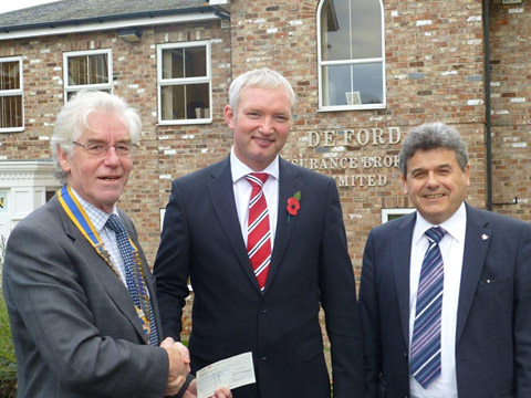 York Viking Rotary Club president Tony Botting, left, and honorary treasurer Cliff Gladwin, right, at the cheque presentation with Chris Greenall, managing director of DE Ford Insurance Brokers