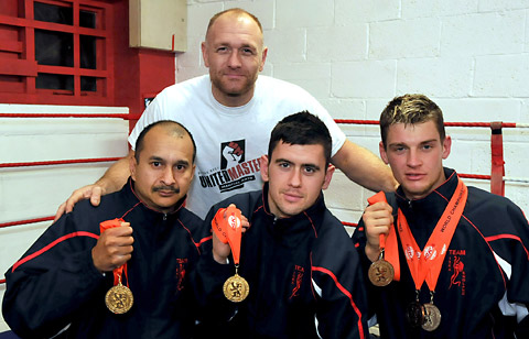 World title winners from left, Tony Dias, Stu Phillips and Martin Baulkalns with trainer Gaz Watkinson at the rear