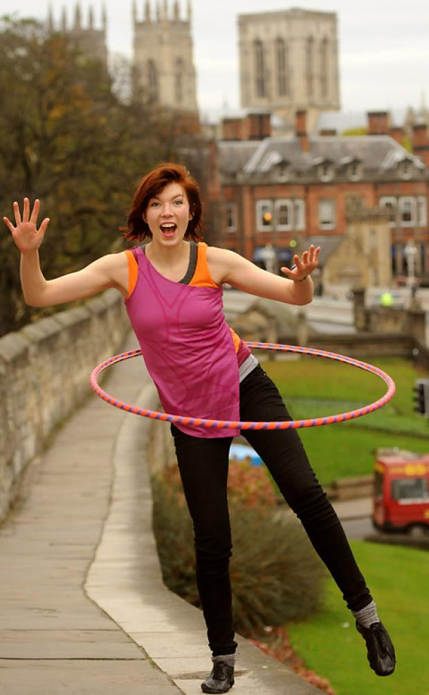 Sarah Greenslade gets in some practice for her hula-hoop marathon around the city walls