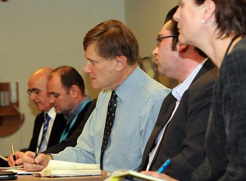 York Central MP Hugh Bayley takes notes as he sits on the flood panel at the York Novotel